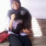 That is my picture with a gibbon = siamang. That picture was taken when I am in period second semester.